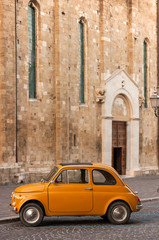 Old Italian Car in Front of a Catholic Church