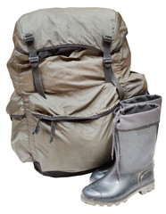 backpack and gumboots isolated on white