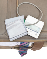 top view of sphygmometer on suitcase with ties