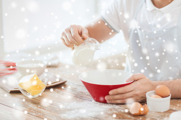 close up of man pouring milk to bowl