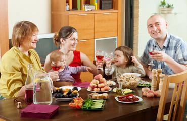 happy  family  around festive table