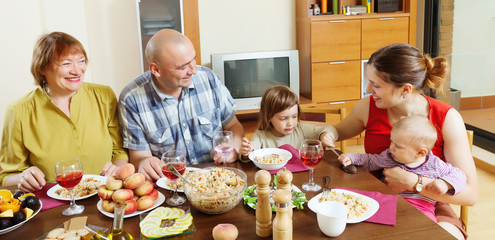 happy multigeneration family communicate over  table