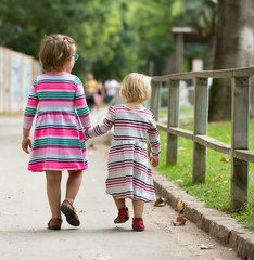 Rear view of two little girls
