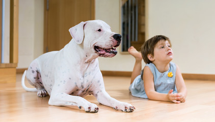 nice female toddler on the floor with dog