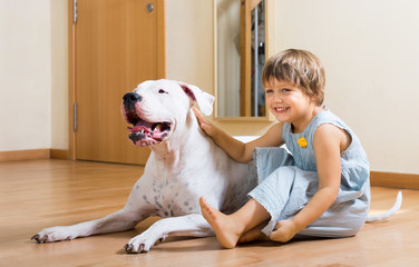 small smiling girl on the floor with dog