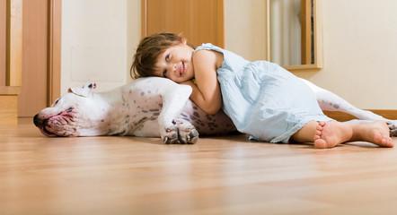little nice girl on the floor with dog