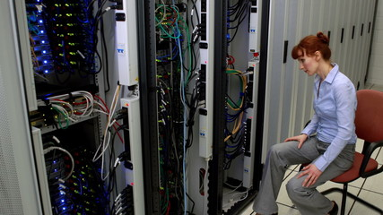 Technician working beside open server