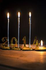 Capodanno rappresentato dal numero 2014 con le candele