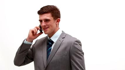 Businessman talking on phone white background