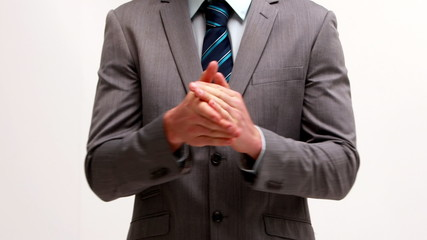 Businessman clapping on white background