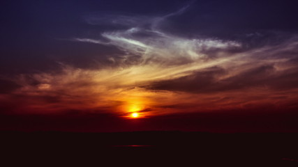 The picturesque sunset (sunrise) with clouds, wide angle view