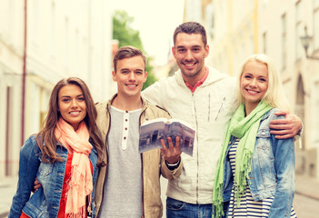 group of friends with city guide exploring town