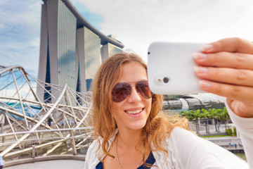 Young woman taking pictures of her self