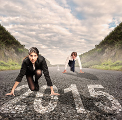 man versus woman on a road with year 2015 painted on it
