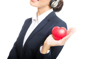 Young call center woman holding heart model
