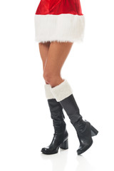 Female slim legs in santa boots