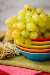 Green Grapes on Colorful Plates and Napkins