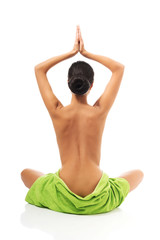 Back view woman sitting excercising yoga