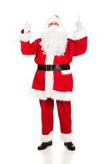 Full length Santa Claus pointing his hands up