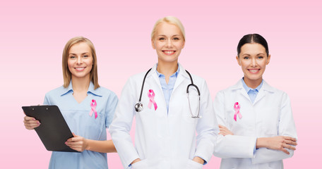 female doctors with breast cancer awareness ribbon