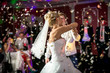 blonde bride dancing at restaurant in flying confetti - 74262296