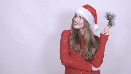 Attractive smiling woman in christmas hat, studio shot.