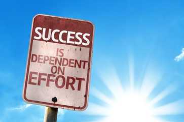 Success is Dependent on Effort sign with sky