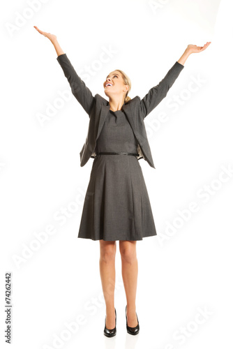 canvas print picture Beautiful woman raising arms high