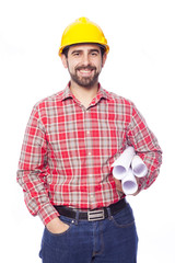 Portrait of smiling young architect holding blueprints on white