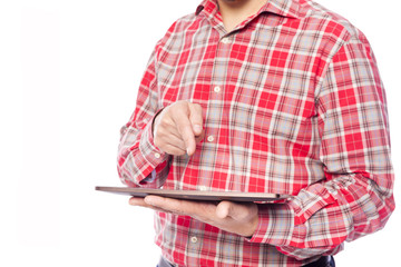 Man working with a tablet, isolated on white background