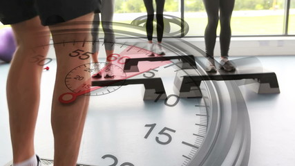 Stopwatch graphic over step aerobics class