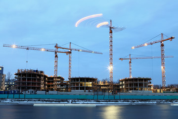 Construction site of  residential building, tower cranes with ev