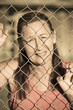 Devastated Woman stressed at prison fence