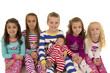 Portrait of six adorable children wearing winter pajamas