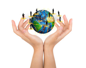 Two woman hands hold earth of social network (Elements of this i