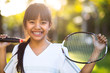 Little asian girl holding a badminton racket