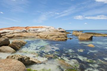 Colourful rocks at Bay of Fire beach Tasmania, Australia
