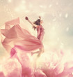 Beautiful young woman jumping on a giant flower - 74266049