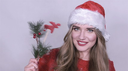 Attractive woman in christmas hat on white background.