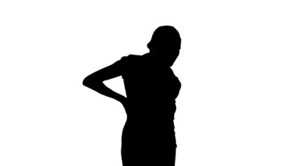 Woman getting back pain in black silhouette