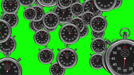 Stopwatches falling on green background