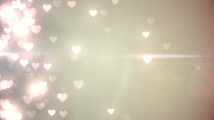 Glittering hearts on pale background