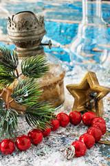 old-fashioned kerosene lamp and Christmas toys
