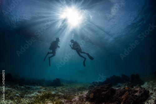 scuba divers start a dive - 74269075