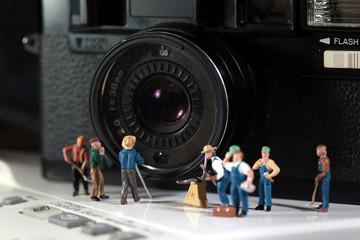 team makes maintenance of old camera.