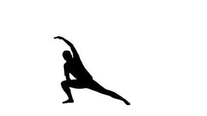 Woman doing yoga in black silhouette