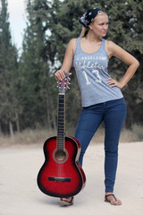 Blond woman with a guitar