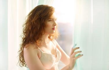 Cute girl standing near the window