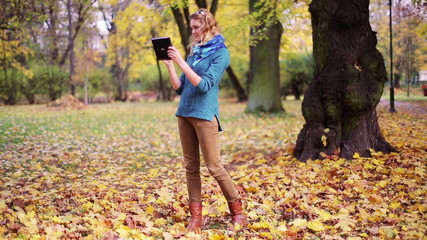 Girl taking photo of nature in the park