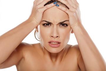 portrait of angry unsatisfied women in belpoj background